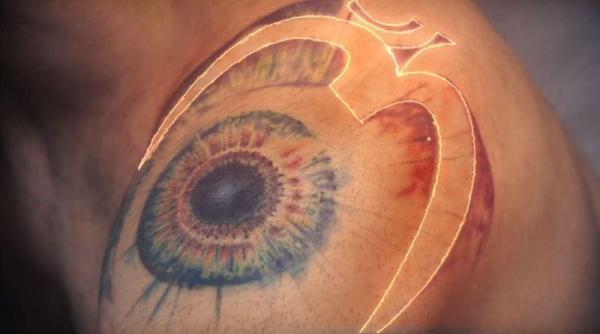 OM Tattoo on Shoulder