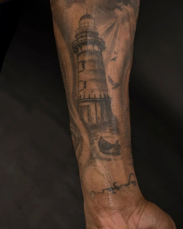Lighthouse on his left forearm