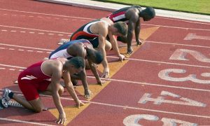 What are field events in athletics?